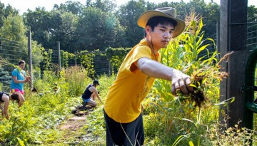 student working on farm