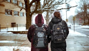Students walk in snow