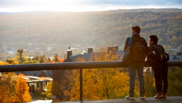 Students look over West Campus in fall.