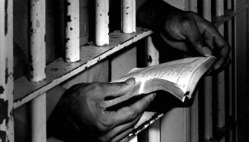 inmate looking at book