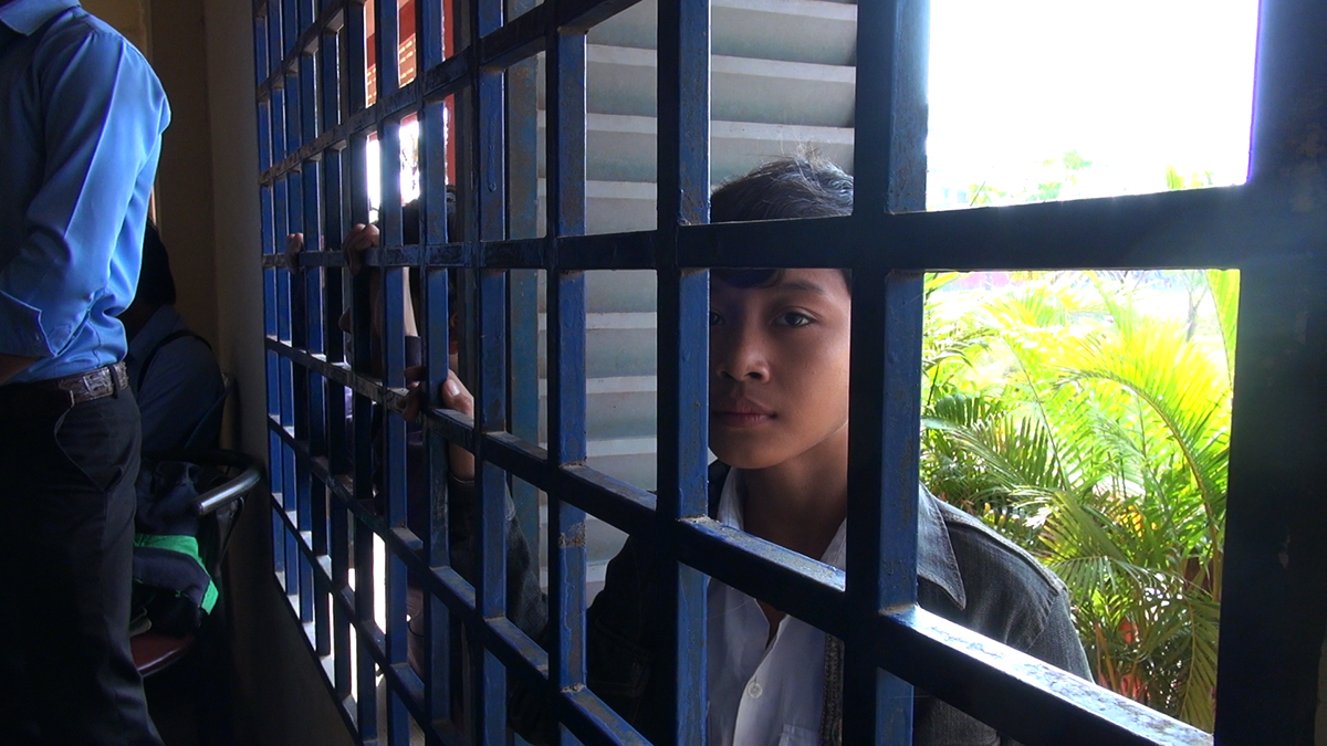 Boy in barred window