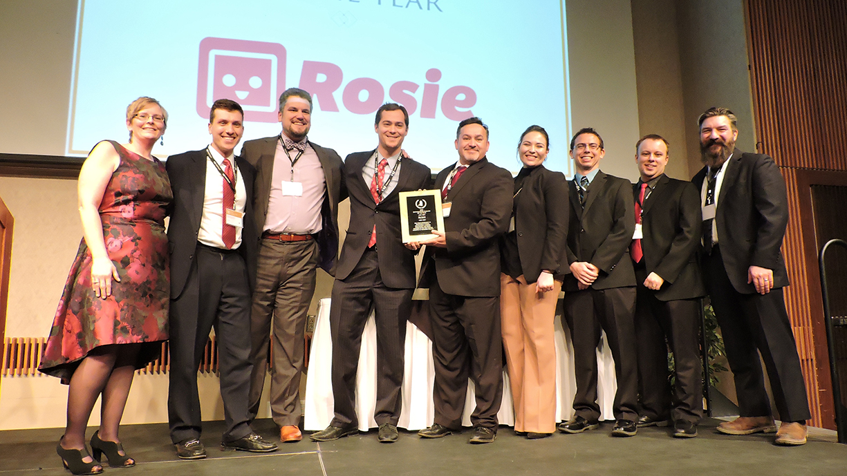 Rosie Applications team accepts Chamber of Commerce Award