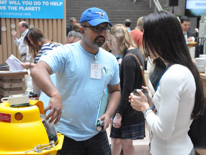 Ashik Rahaman, research analyst from the Lab of Ornithology, shows a bioacoustic buoy to Vanessa Constant '14
