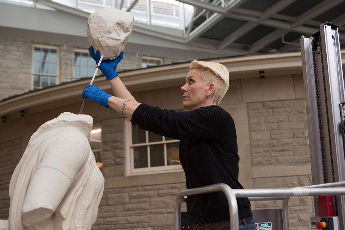 Maloney adds head to statue