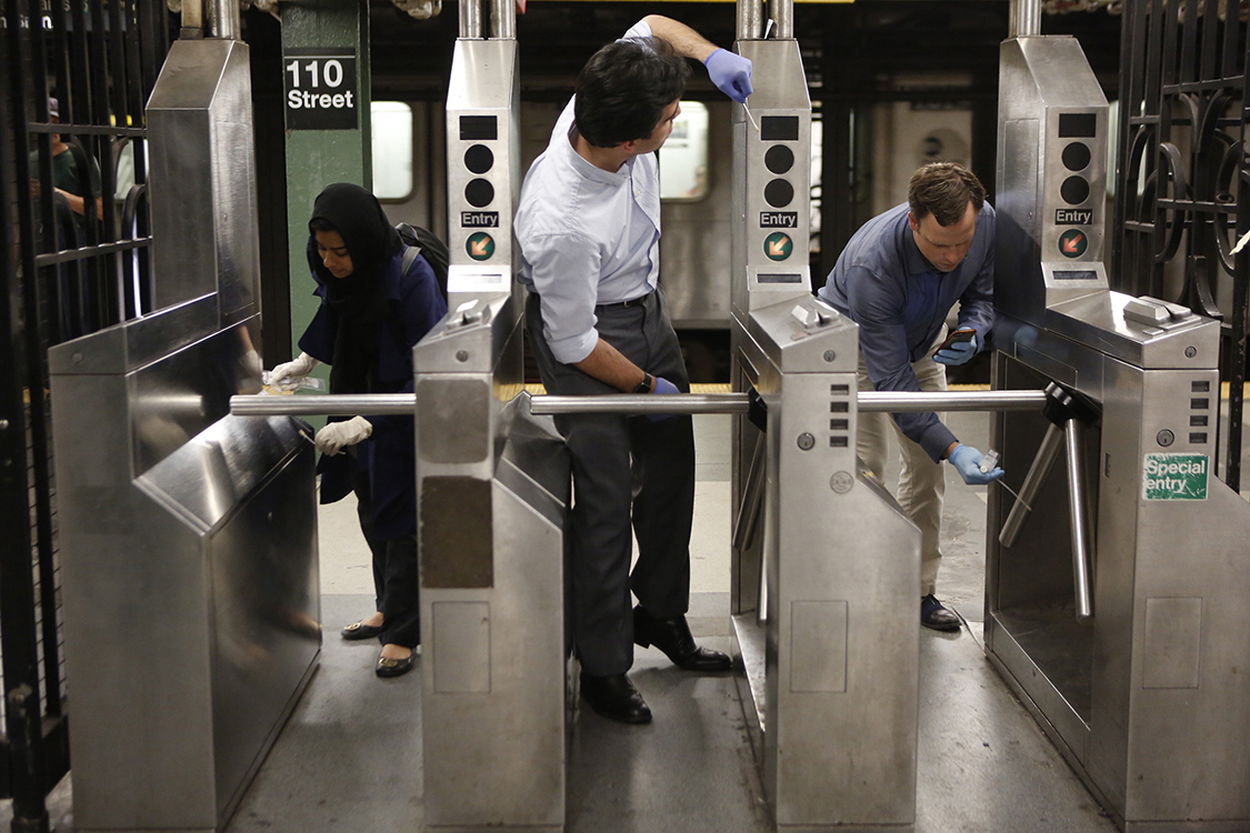 swabbing subway turnstile