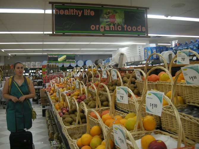 Elaine Hill conducts research at an independent grocery store