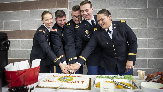 New officers cut cake