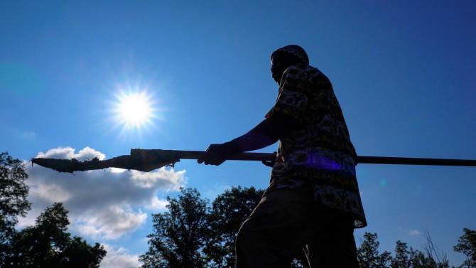 Nfamara Badjie holds a kajundu