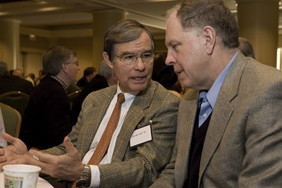 Cornell trustee David Croll speaks with Jeff Tester during a conference