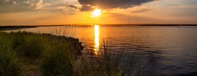 Sunset With Bridge Over Water