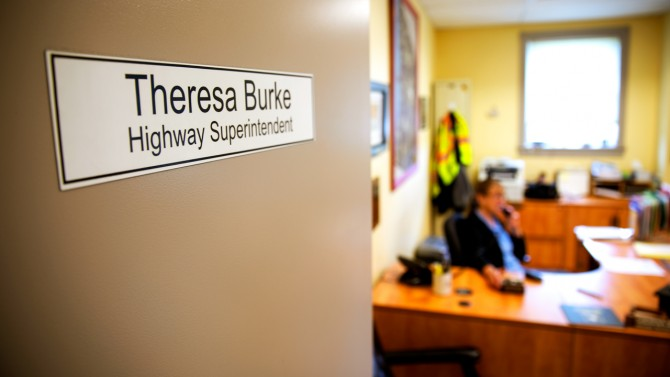 Office door with 'Theresa Burke Highway Superintendent' name tag