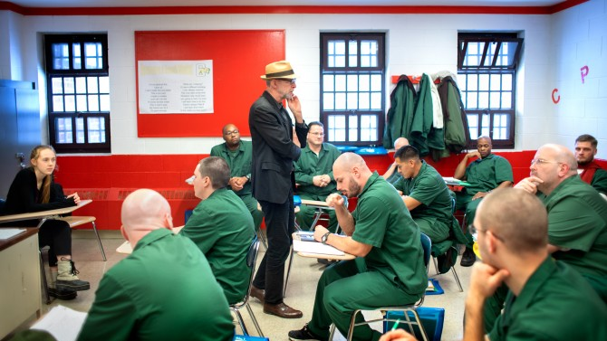 A professor teaches students in a prison