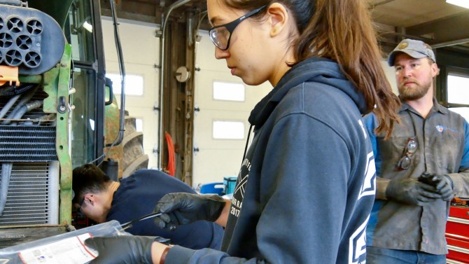 Sophia Openshaw works on biodiesel tractor