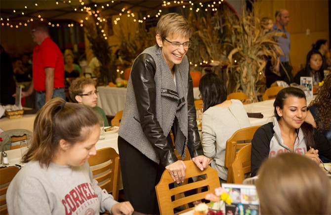 President Elizabeth Garrett chats with students at the 2015 Farm 2 Fork dinner