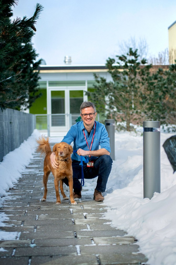 Dr. Jan Krumsiek with Noma, a canine biobank donor