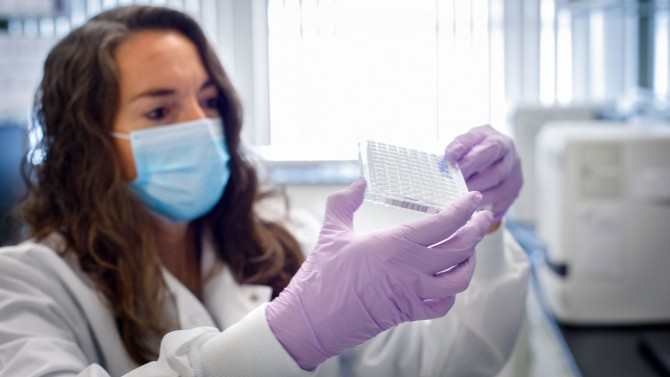 Researcher looks at Cover test samples