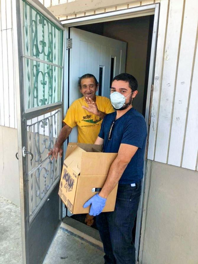 Volunteer James Mercado delivers goods