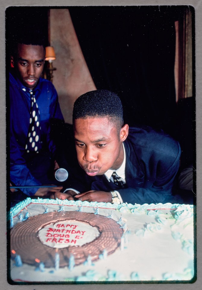 Doug E. Fresh blows out the candles on his birthday cake