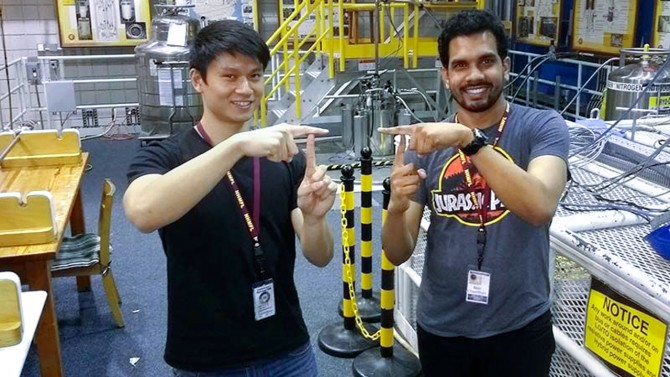 Doctoral students Phillip Dang (left) and Reet Chaudhuri at the National High Magnetic Field Laboratory