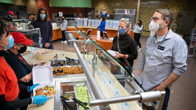 C. Lindsay Anderson and Steven Jackson grab a takeout meal in the Keeton House dining facility