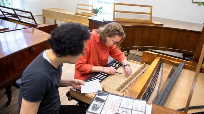 Lee and Zabelina regulate a piano modeled after Johann Schantz (ca. 1800) by Thomas and Barbara Wolf.
