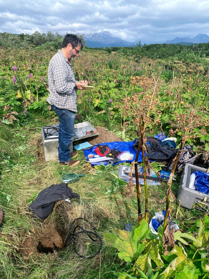 Geoffrey Abers, the William and Katherine Snee Professor in Geological Sciences, deploys a temporary seismometer on Kodiak Island in August.