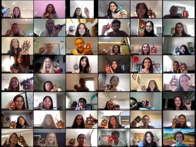 48 students hold up electronic devices on a video call
