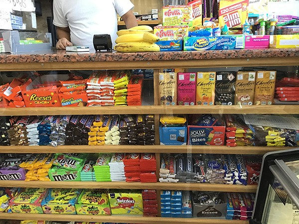 A few lone bananas can be found among a sea of candy near a cash register in a Harlem bodega. A youth participant captured the image as part of a photojournalism project, which the group used to create their bodega improvement plans.