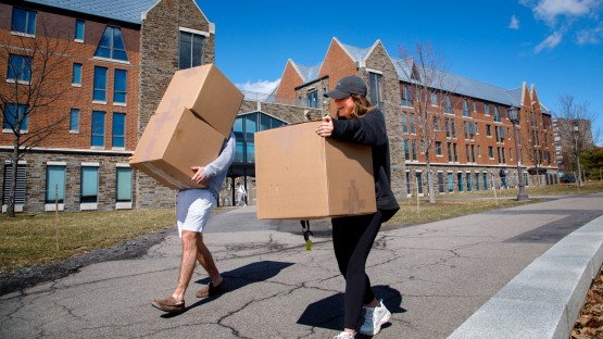 Emily Chrisman '23 gets some help moving boxes from her friend Jack Malone '23 out of Mews Hall on North Campus.