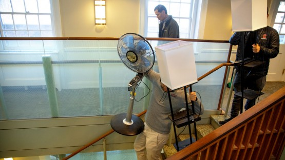 Student with fan walking down stairs