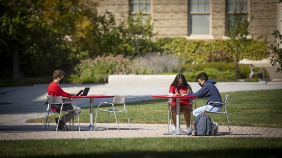 Students soak up the afternoon sun while working on the Ag Quad.