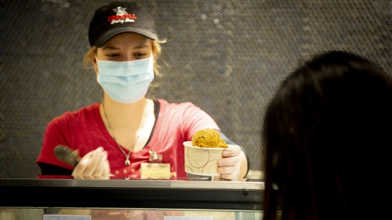 Ice cream is served up on a warm fall day at the Cornell Dairy Bar in Stocking Hall.