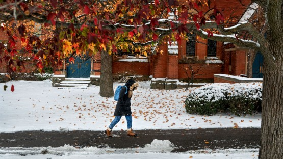 Fall colors hang on as an early snow lands on campus.