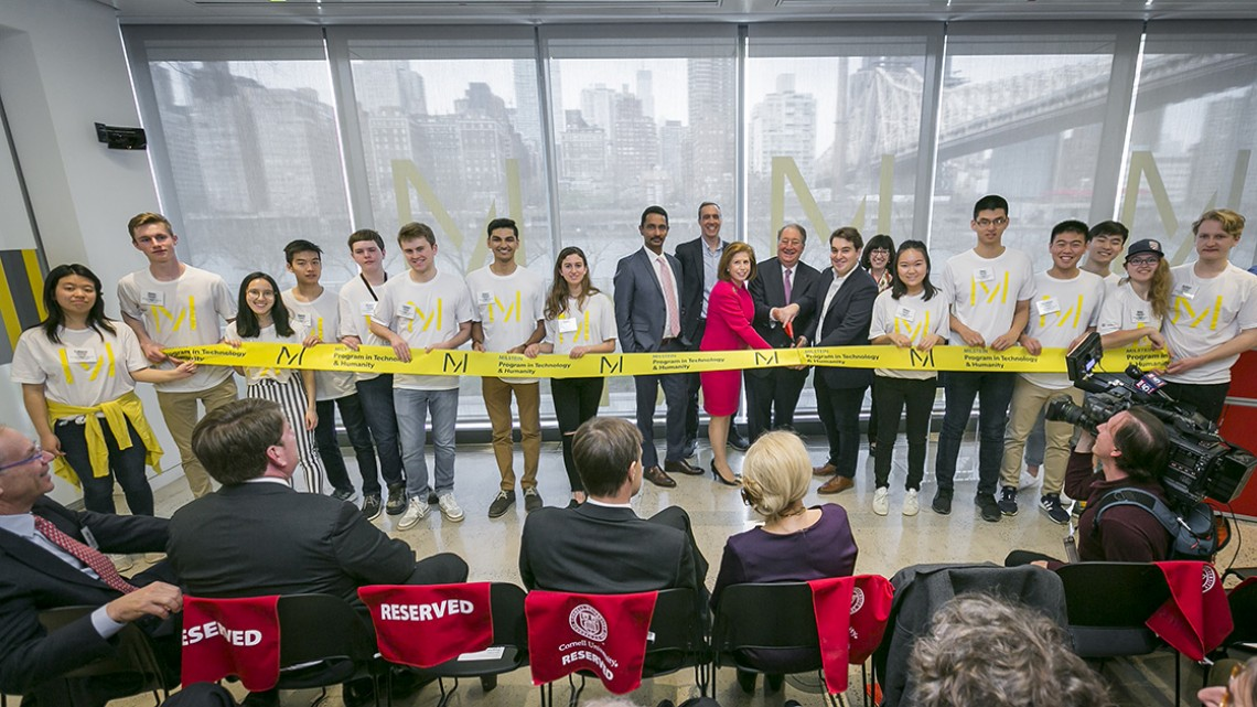Abby, Howard '73, and Michael '11 Milstein cut a ribbon to celebrate the Cornell Tech launch of the Milstein Program in Technology and Humanity