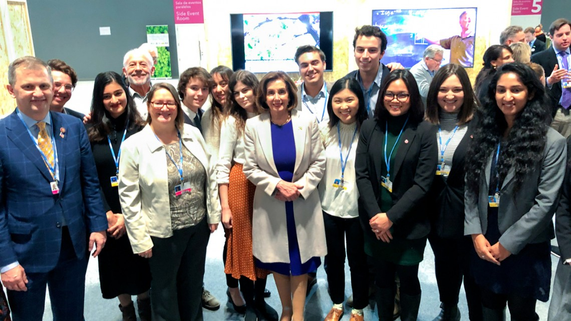 Pelosi and students at COP25