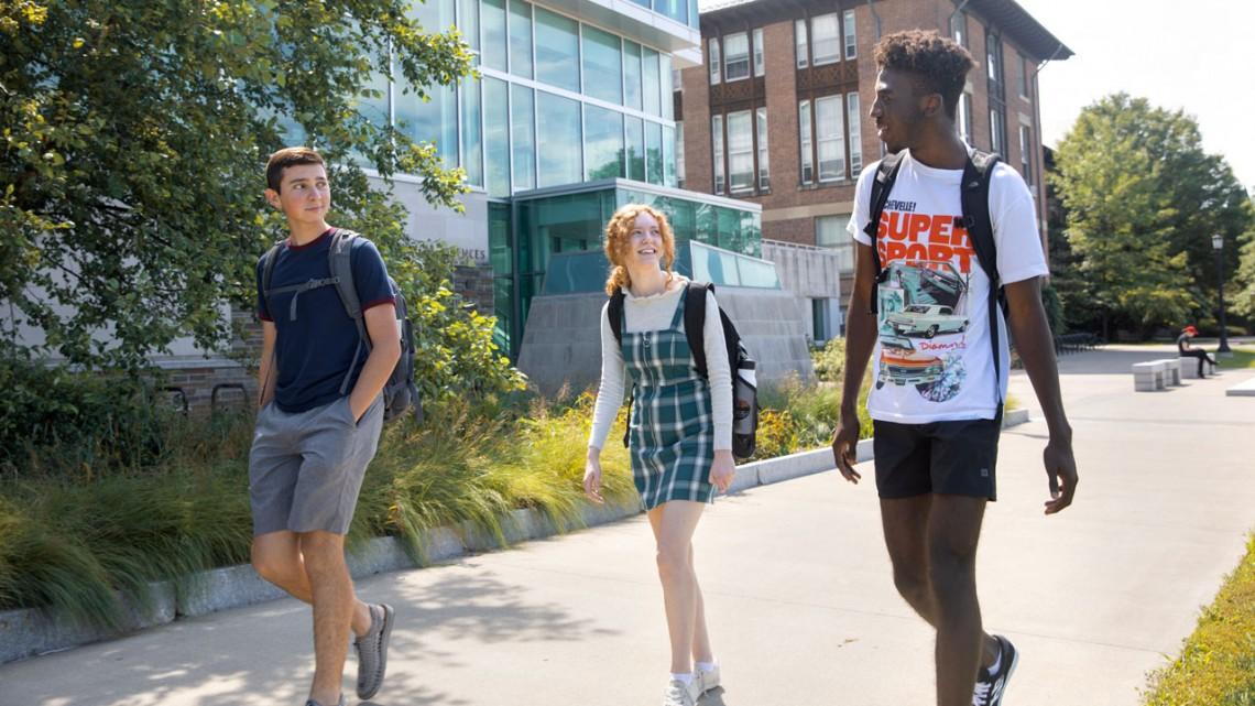 Pre-Freshman Summer Program students Canyon Cross, Delia Ferry and Lukman Moyosore catch up after class.