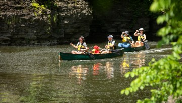 Reunion attendees canoeing on Beebe Lake.