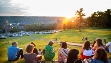Reunion attendees watching the sunset from Libe Slope.