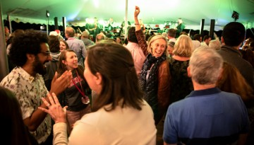 Reunion attendees dancing under the tent.