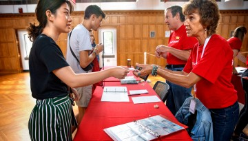 Volunteers assist new students in Willard Straight Hall.