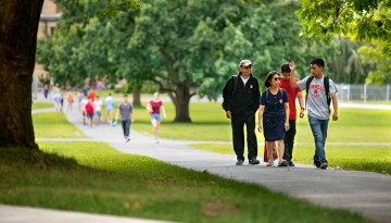 A family walking on campus.