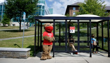Big Red Bear waits for TCAT bus