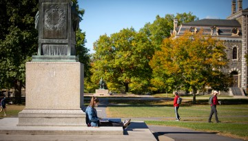 Student sitting at AD White statue