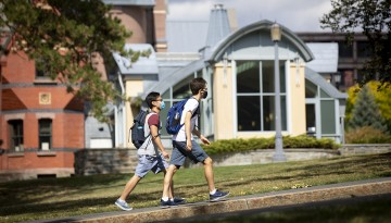 Students walk past Sage Hall.