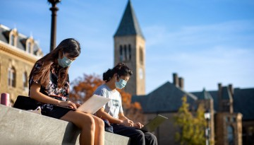 Students study an the top of Libe Slope on a warm afternoon.