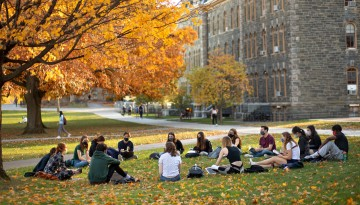 Classes meet on a the Arts Quad on a beautiful fall afternoon.