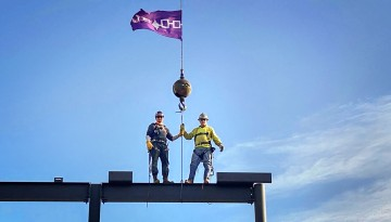 Ironworkers with Hiawatha wampum belt on top of NCRE building