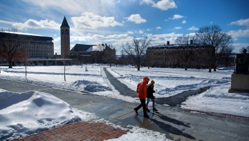 The sun shines on a snow-covered Arts Quad.