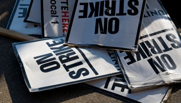 Strike signs in a pile