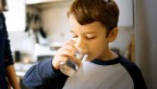 Boy drinking glass of water
